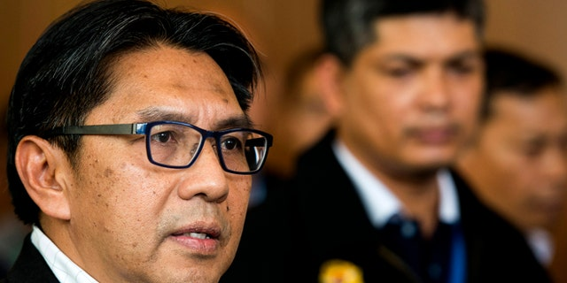 April 2, 2014: Malaysia's civil aviation chief Azharuddin Abdul Rahman, left, is accompanied by an unidentified Malaysia Airlines official while answering questions during a press conference after a close door meeting with Chinese relatives of the passengers onboard the missing Malaysia Airlines Flight 370 at a hotel in Bangi, on the outskirts of Kuala Lumpur, Malaysia.