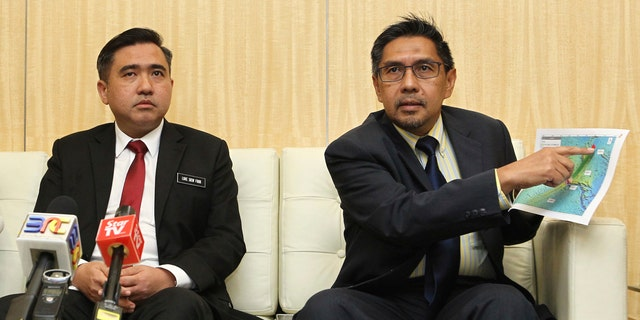 Director general of the Malaysian Department of Civil Aviation, Azharuddin Abdul Rahman, right, shows the search area map during a press conference as Malaysia new Transport Minister Anthony Loke Siew Fook looks on in Putrajaya, Malaysia on Wednesday, May 23, 2018.