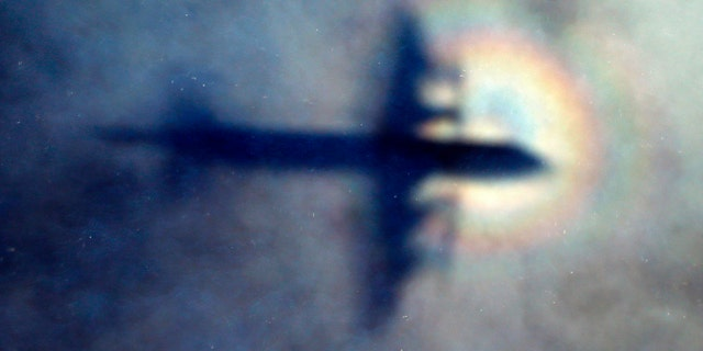 File photo - In this March 31, 2014 file photo, the shadow of a Royal New Zealand Air Force P3 Orion is seen on low level cloud while the aircraft searches for missing Malaysia Airlines Flight MH370 in the southern Indian Ocean, near the coast of Western Australia. (AP Photo/Rob Griffith, File)