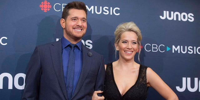 FILE - In this March 25, 2018 file photo, Michael Buble and his wife Luisana Lopilato at the Juno Awards in Vancouver, British Columbia. Buble and Lopilato are the proud parents of a baby girl. Buble's representative says that Vida Amber Betty was born Wednesday in Vancouver. She is 6 pounds, 1 ounce. Buble and Lopilato also have two sons, Elias and Noah. Lopilato, an Argentine TV actress, posted a photo of her baby girl's hand Thursday on Instagram.