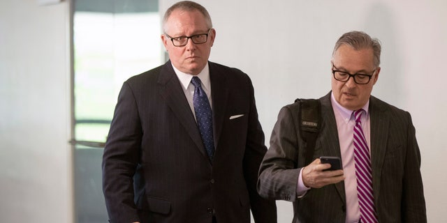 Michael Caputo, left, and attorney Dennis Vacco leave Caputo's interview with Senate Intelligence Committee staff on Capitol Hill in Washington Tuesday. (AP Photo/J. Scott Applewhite)
