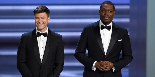 Co-hosts Colin Jost, left, and Michael Che, right, poked fun at Roseanne Barr during the Emmy Awards.