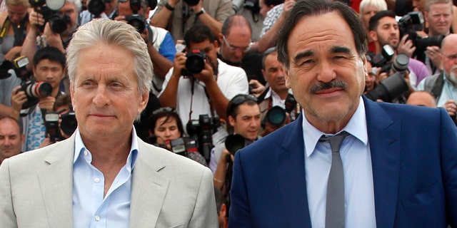 """Michael Douglas, left, poses with director Oliver Stone during a photocall for """"Wall Street - Money Never Sleeps."""""""