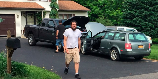 Michael Rotondo, 30, prepares to leave his parents' house in Camillus, N.Y., Friday, June 1, 2018.