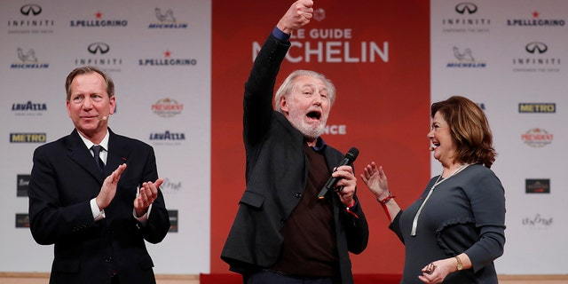 French chef Pierre Gagnaire reacts after earning an award at the 2018 Michelin ceremony.