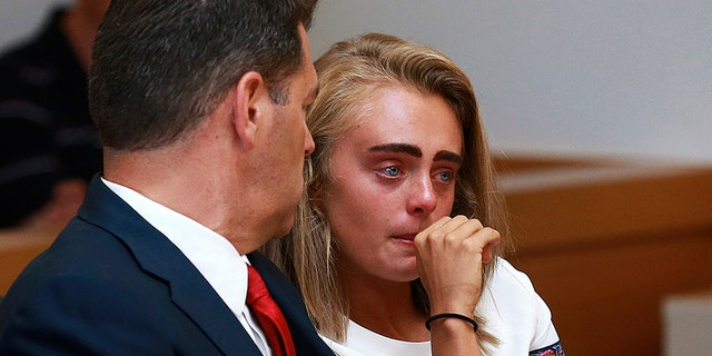 Michelle Carter awaits her sentencing in a courtroom in Taunton, Mass.