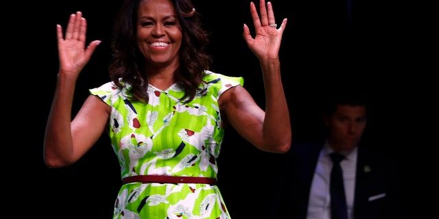 Former first lady Michelle Obama waves as she arrives to speak at the American Library Association annual conference in New Orleans, Friday, June 22, 2018.