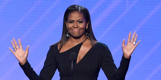 FILE - In this July 12, 2017, file photo, former first lady Michelle Obama presents the Arthur Ashe Courage Award at the ESPYS at the Microsoft Theater in Los Angeles.