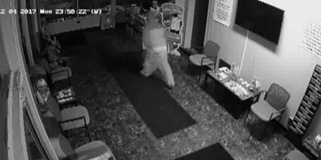 Dec. 4, 2017: A burglar pulls up his pants after tripping and falling at an auto body shop in Waterford Township, Mich.