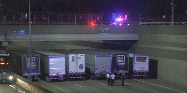 The trucks were parked under the bridge for several hours while police negotiated with the man.