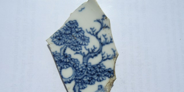 A porcelain fragment discovered at Colonial Michilimackinac (Mackinac State Historic Parks)