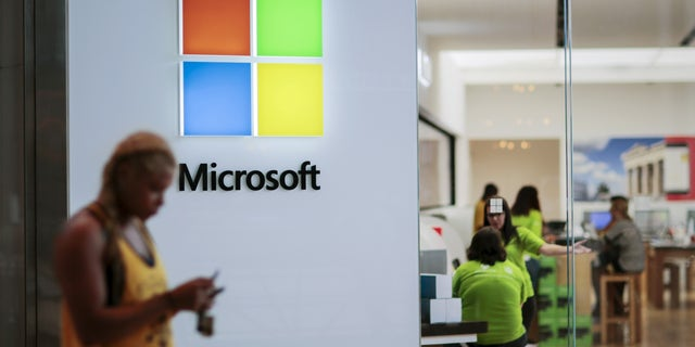 People visit a Microsoft store in Paramus, New Jersey on July 8, 2015.
