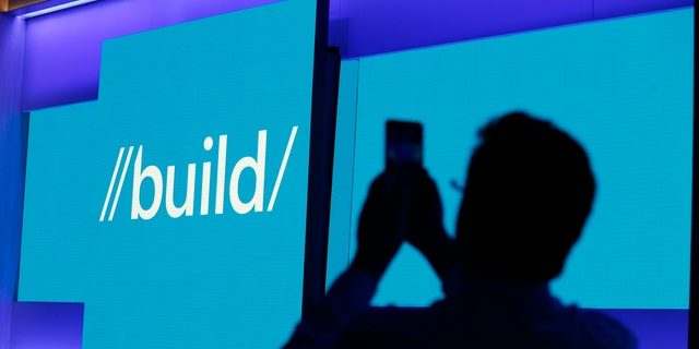 File photo - An attendee takes a picture before the keynote address during the Microsoft Build 2016 Developer Conference in San Francisco, Calif. March 30, 2016. (REUTERS/Beck Diefenbach)