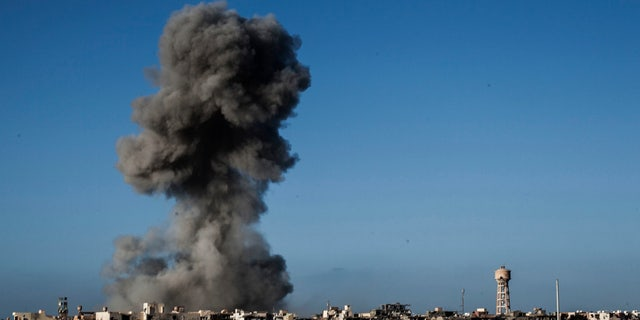 Sept. 28, 2016: Smoke rises after an airstrike on an ISIS-held area of Sirte, Libya.