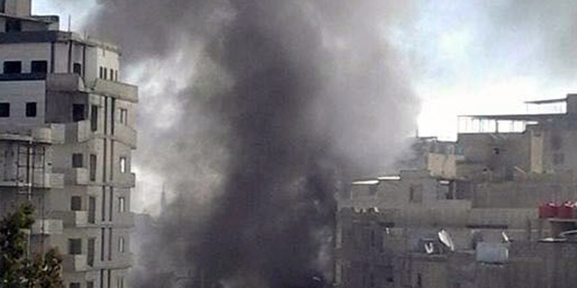Smoke rises in Damascus after a triple bombing.