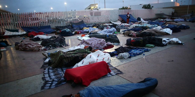 Members of a caravan of migrants from Central America spent the night near the San Ysidro checkpoint after a small group of fellow migrants entered the United States border and customs facility, where they are expected to apply for asylum, in Tijuana, Mexico April 29, 2018.
