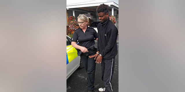 Paul Edmunds gave the Ethiopian migrant chocolate and water while they waited for police to arrive. He was then turned over to UK immigration officials.