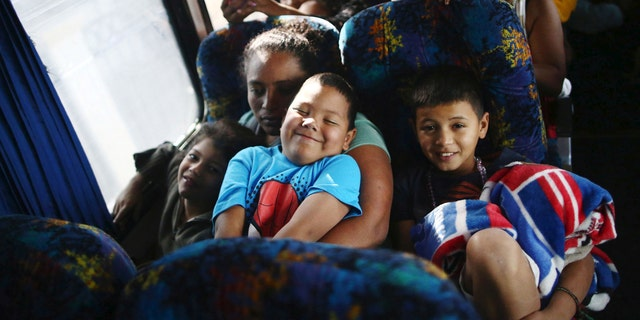 Central American migrants, moving in a caravan through Mexico, smile as they travel to Hermosillo in a new route of his travel, in Mazatlan, in Sinaloa state, Mexico, April 21, 2018.