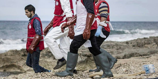 Libyan Red Crescent workers recovering bodies of people that washed ashore near Zawiya, Libya.
