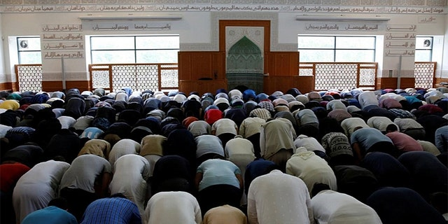 Men participate in the Friday prayer in The Grand Mosque of Copenhagen, officially known as the Hamad Bin Khalifa Civilisation Center, a Sunni mosque popular with residents of nearby Mjolnerparken.