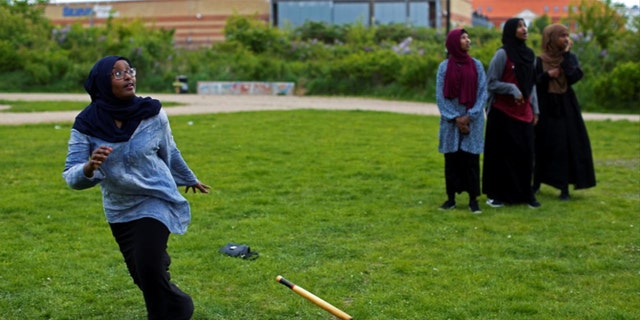 """A group of women of Somali descent play rounders in a park in Mjolnerparken, a housing estate featured on the Danish government's """"Ghetto List."""""""