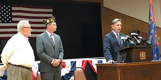 Oklahoma Attorney General Mike Hunter announced a 20-count indictment charging a Tulsa man with charity fraud. On hand were AARP's Wayne Blackmon (left) and Oklahoma VFW Commander Joshua Starks.