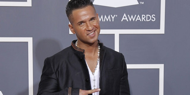 """TV personality Michael """"The Situation"""" Sorrentino arrives at the 53rd annual Grammy Awards in Los Angeles, California February 13, 2011. REUTERS/Danny Moloshok (UNITED STATES - Tags: ENTERTAINMENT) (GRAMMYS-ARRIVALS) - RTR2IJT3"""