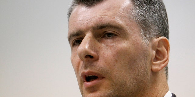 Russian billionaire Mikhail Prokhorov speaks during a 2013 news conference.