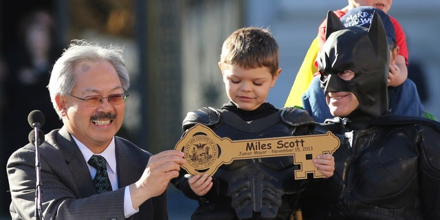 Nov. 15, 2013: Five-year-old leukemia survivor Miles Scott, dressed as Batkid, receives a key to the city declaring him Junior Mayor from San Francisco from Mayor Ed Lee, left, during a ceremony as part of a day arranged by the Make-A-Wish Foundation in San Francisco, Calif.