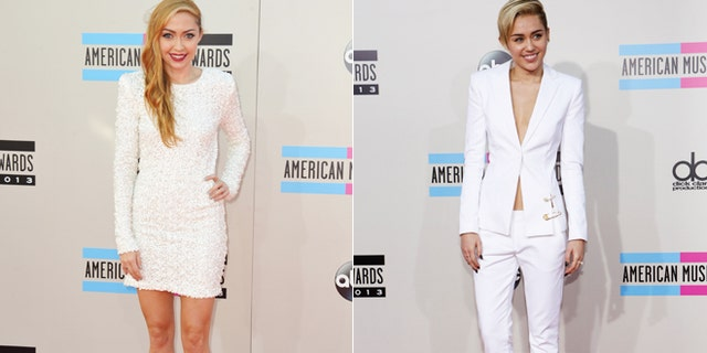 Brandi Cyrus, left, and Miley Cyrus arrive at the AMAs on Nov. 25, 2013.