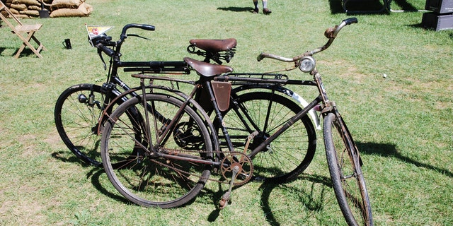 A pair of Swiss Army Bikes. Hundreds of these bikes were sold off as military surplus in the 1990s and when maintained can still be ridden today. The front bike likely dates to the 1930s or possibly earlier and has a simple front brake that literally is lowered on the tire when the brake is engaged. The rear bike is a post-war version, and each has only a single gear! (Photo: Peter Suciu, Private Collection)