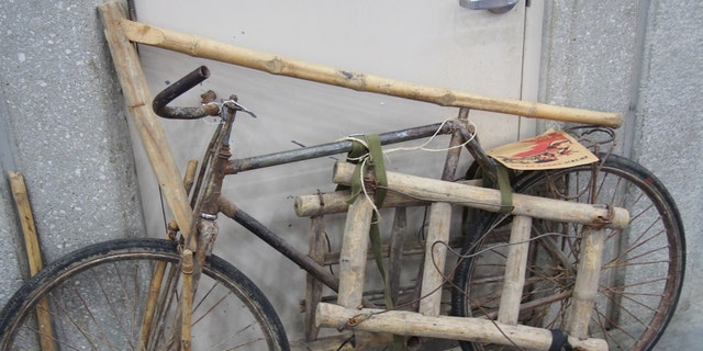 """A pre-World War II French bicycle that has been heavily modified to move material on the infamous """"Ho Chi Minh Trial"""" in Southeast Asia during the Vietnam War. This bike couldn't be ridden but instead served a role like a pack mule. It was offered for sale at a collector's show. (Photo: Peter Suciu, Private Collection)"""