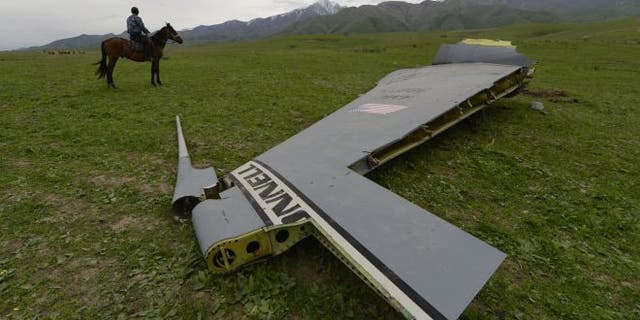 May 3, 2013 - A U.S. Air Force KC-135 tanker aircraft wreckage is strewn across a field near the village of Chaldovar, Kyrgyzstan.