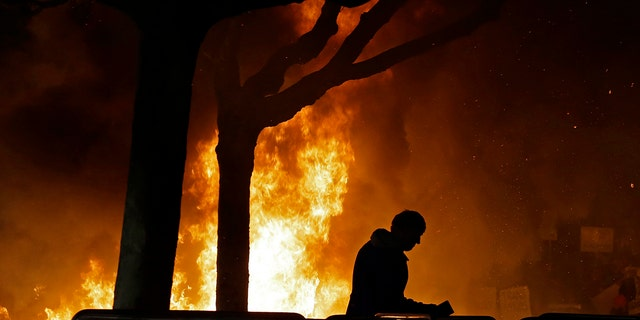 A fire set by demonstrators protesting a scheduled speaking appearance by Milo Yiannopoulos burns on Sproul Plaza at the University of California, Berkeley campus, Feb. 1, 2017.