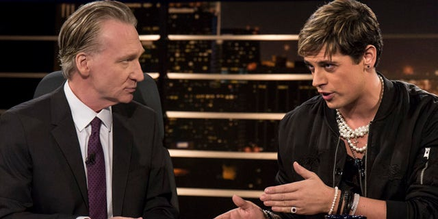 "In this photo provided by HBO, host Bill Maher, left, listens to Milo Yiannopoulos, a writer for Breitbart News, on HBO's ""Real Time with Bill Maher,"" Friday, Feb. 17, 2017, in Los Angeles. (Janet Van Ham/HBO via AP)"