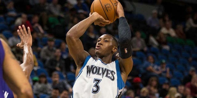 Oct 21, 2016; Minneapolis, MN, USA; Minnesota Timberwolves guard Kris Dunn (3) shoots the ball during the fourth quarter against the Charlotte Hornets at Target Center. The Timberwolves won 109-74. Mandatory Credit: Brace Hemmelgarn-USA TODAY Sports