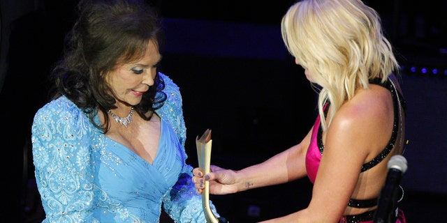Loretta Lynn, left, accepts her award from Miranda Lambert at the 9th Annual ACM Honors at The Ryman Auditorium on Tuesday, Sept. 1, 2015 in Nashville, Tenn.