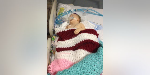 May 28, 2016: In this file photo provided by Patrick Lawson, his daughter Mirranda grace Lawson lies in her hospital bed at Virginia Commonwealth University Medical College of Virginia in Richmond, Va.