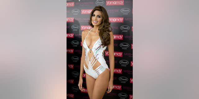 Miss Universe 2013 Gabriela Isler, from Venezuela, presents the Yamamay Million Dollar Swimsuit for Miss Universe after the 2013 Miss Universe pageant in Moscow, Russia, on Sunday, Nov. 10, 2013. The emerald, ruby and diamond swimsuit is valued at one million dollars. (AP Photo/Pavel Golovkin)