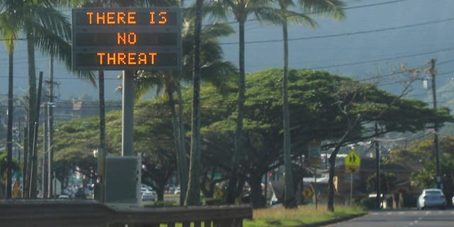 "This Saturday, Jan. 13, 2018, photo provided by Jhune Liwanag shows a highway median sign broadcasting a message of ""There is no threat"" in Kaneohe, Hawaii."