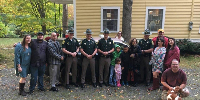 Photograph of the wedding party, along with members of New Hampshire State Police and NH Fish and Game.