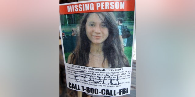 July 22, 2014: In this file photo of a missing person poster of Abigail Hernandez displayed in a storefront window in North Conway, N.H., shows Hernandez has been found.