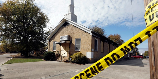 "Crime scene tape outlines the perimeter of the Hopewell Missionary Baptist Church in Greenville, Miss., on Tuesday, Nov. 22, 2016, after the church was burned and spray-painted with ""Vote Trump,"" three weeks ago. T"