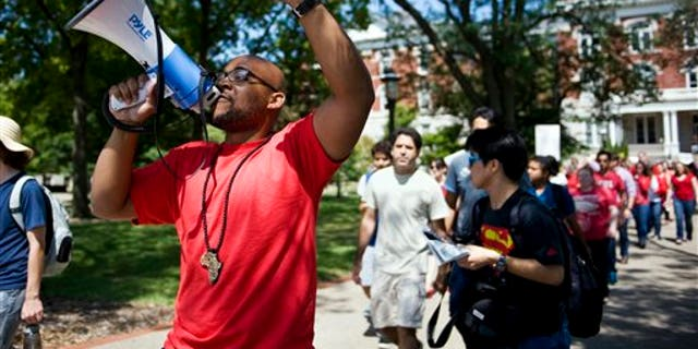 "Aug. 26, 2015: A ""day of action"" demonstration to draw attention to graduate students' demands in front of Jesse Hall on the Mizzou campus in Columbia."