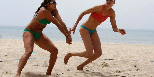 FILE 2012: U.S. beach volleyball players Kerri Walsh, right, and her partner Misty May train for the London 2012 Olympics in Manhattan Beach, California.