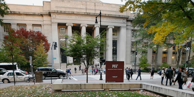 In this Oct. 21, 2015, file photo, students walk on the Massachusetts Institute of Technology campus in Cambridge, Mass.