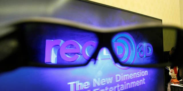 Mitsubishi 3D glasses are shown in front of an 82-inch Mitsubishi Home Theater TV with 3D-Ready technology at the Consumer Electronics Show (CES) in Las Vegas.