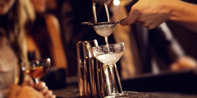Bartender Serving Cocktail Drinks