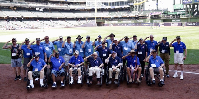 WWII vets in navy blue, Korean War vets in royal blue and Vietnam vets in light blue were honored at a Brewers game.
