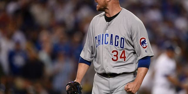 Oct 20, 2016; Los Angeles, CA, USA; Chicago Cubs starting pitcher Jon Lester (34) reacts after the third out in the third inning against the Los Angeles Dodgers in game five of the 2016 NLCS playoff baseball series against the Los Angeles Dodgers at Dodger Stadium. Mandatory Credit: Kelvin Kuo-USA TODAY Sports